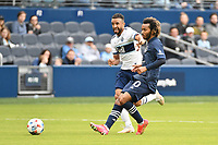 KANSAS CITY, KS - MAY 16: Gianluca Busio #10 Sporting KC passes the ball during a game between Vancouver Whitecaps and Sporting Kansas City at Children's Mercy Park on May 16, 2021 in Kansas City, Kansas.