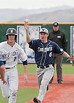 March 30, 2012:   Nevada Wolf Pack Brooks Klein is chased in a rundown by  BYU Cougars Tanner Chauncey during their NCAA baseball game played at Peccole Park on Friday afternoon in Reno, Nevada.