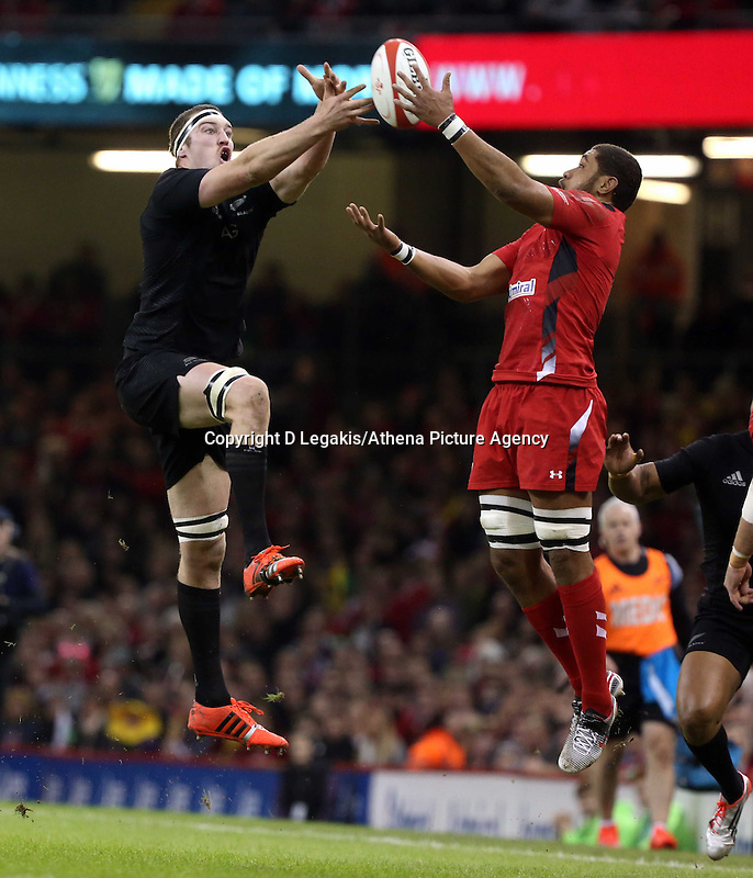 Pictured L-R: Brodie Retallick of New Zealand against Taulupe Faletau of Wales Saturday 22 November 2014<br /> Re: Dove Men Series 2014 rugby, Wales v New Zealand at the Millennium Stadium, Cardiff, south Wales, UK.