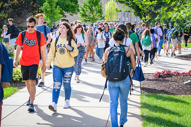August 30, 2019; Students walk on South Quad between classes. (Photo by Matt Cashore/University of Notre Dame)