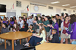 Bush Elementary students gather in the library to watch their principal, Theresa Rose, be suprised Wednesday with the honor of HISD Elementary Principal of the Year.