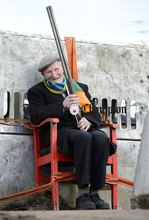 A senior gun club member with his gun during the St Patrick's Day parade in Tulla. Photograph by John Kelly.