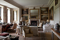 Hunting paintings decorate the walls of this cosy living room
