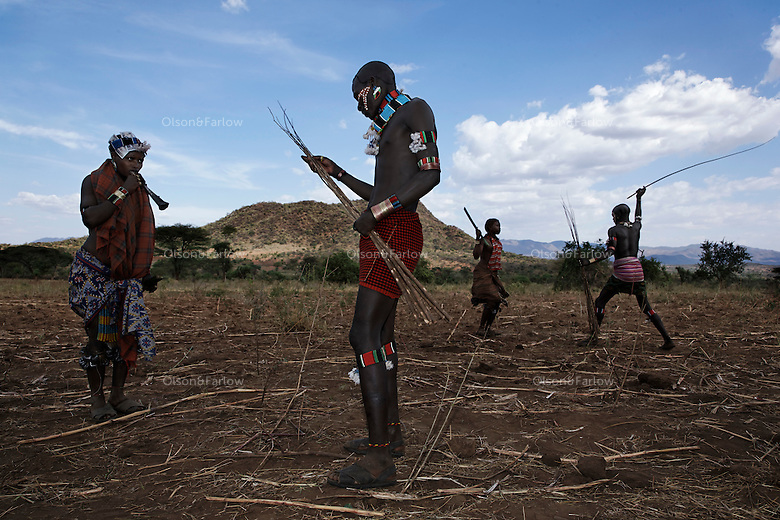 At the beginning of a manhood ceremony, women blow little horns begging and intimidating men to  whip them.  Women are left scarred but it is their symbol of belonging to the social and support structure of the Hamar, Karo and Bene tribes.