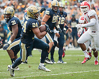 Pitt running back James Conner. The Pitt Panthers football team defeated the Youngstown State Penguins 45-37 on Saturday, September 5, 2015 at Heinz Field, Pittsburgh, Pennsylvania.