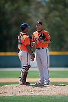 Baltimore Orioles pitcher Tobias Myers (73) talks with catcher Yermin Mercedes (66) during a minor league Spring Training game against the Tampa Bay Rays on March 29, 2017 at the Buck O'Neil Baseball Complex in Sarasota, Florida.  (Mike Janes/Four Seam Images)