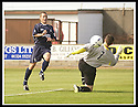 23/08/2003                   Copyright Pic : James Stewart.File Name : stewart-falkirk v qots 01.CRAIG MCPHERSON KNOCKS THE BALL PAST JOHN DODDS BUT THE BALL GOES NARROWLY PAST THE POST.....James Stewart Photo Agency, 19 Carronlea Drive, Falkirk. FK2 8DN      Vat Reg No. 607 6932 25.Office     : +44 (0)1324 570906     .Mobile  : +44 (0)7721 416997.Fax         :  +44 (0)1324 570906.E-mail  :  jim@jspa.co.uk.If you require further information then contact Jim Stewart on any of the numbers above.........