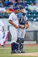 Wilmington Blue Rocks catcher Cam Gallagher (35) has a chat on the mound with starting pitcher Miguel Almonte (27) during the game against the Winston-Salem Dash at BB&T Ballpark on April 3, 2014 in Winston-Salem, North Carolina.  The Blue Rocks defeated the Dash 3-1.  (Brian Westerholt/Four Seam Images)