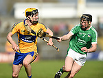Padraic O Loughlin of Clare in action against Brian Mc Partland of Limerick during their Munster U-21 hurling quarter final at Cusack park. Photograph by John Kelly.