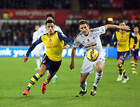 Sunday 09 November 2014 <br /> L-R Alexis Sanchez of Arsenal is challenged by Angel Rangel of Swansea<br /> Barclays Premier League, Swansea City FC v Arsenal City at the Liberty Stadium, Swansea, Great Britain.