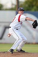 Salem-Keizer pitcher Brian Maloney #39 pitches against the Eugene Emeralds at Volcanoes Stadium on August 9, 2011 in Salem-Keizer,Oregon. Eugene defeated Salem-Keizer 13-7.(Larry Goren/Four Seam Images)