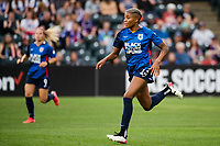 TACOMA, WA - JULY 31: Tziarra King #23 of the OL Reign sprints up the field during a game between Racing Louisville FC and OL Reign at Cheney Stadium on July 31, 2021 in Tacoma, Washington.
