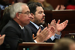 Assembly Minority Leader Pat Hickey, R-Reno, left, and Senate Minority Leader Micheal Roberson, R-Las Vegas, listen as Nevada Gov. Brian Sandoval delivers the State of the State address at the Legislature in Carson City, Nev., on Wednesday, Jan. 16, 2013. (AP Photo/Cathleen Allison)