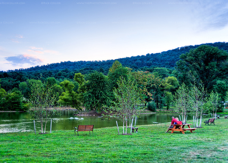 A variety of seating provides ample spots from which to enjoy the wine and the picturesque scenery, around the pond at Doukenie Winery.