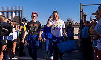 PASADENA, CA - AUGUST 3: Megan Rapinoe #15 and Ashlyn Harris #18 enter the stadium during a game between Ireland and USWNT at Rose Bowl on August 3, 2019 in Pasadena, California.