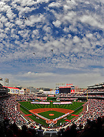 13 April 2009: The Washington Nationals and fans honor America as National Guard helicopters fly by overhead during Opening Ceremonies prior to a game against the Philadelphia Phillies at the Nats' Home Opener at Nationals Park in Washington, DC. The Nats fell short in their 9th inning rally, losing 9-8, and marking their 7th consecutive loss of the 2009 season. Mandatory Credit: Ed Wolfstein Photo