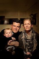 A portrait of Cecilie with her husband and son in their house in Gentofte. Cecilie was the legal guardian of Nepalese orphan Victoria. 19 month old Victoria (formerly named Ghane) was born with hydrocephalus and was left abandoned. Cecilie Hansen was so moved by the story of Ghane she read in a Danish newspaper that she decided to fly to Kathmandu to try to assist her and show her the love of another human being; Cecilie eventually became her legal guardian. Victoria died on November 19 2010 from heart failure. A week after Cecilie's return to Denmark she got a text message from the surgeon reading: 'Dear Cecilie. Be brave. You tried. We all tried. It was her fate. Please try to find peace.'