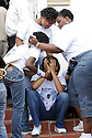 High-school student Riesha Williams mourns the loss of her teacher,  Dinerral Shavers, 25, who died from a gunshot to the back of his head in New Orleans, Sat., Jan. 6, 2007. Shavers was the snare drummer for the Hot 8 Brass Band and the music teacher at L.E. Rabouin High School, where he had recently begun the school's first-ever marching band. He was killed by a teen who was trying to shoot his stepson. ..(Cheryl Gerber photo).