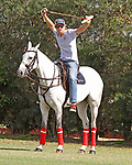 WELLINGTON, FL - APRIL 15:  Groom stretches during half-time.  Scenes from the $100,000 World Cup Final, at the Grand Champions Polo Club, on April 15, 2017 in Wellington, Florida. (Photo by Liz Lamont/Eclipse Sportswire/Getty Images)