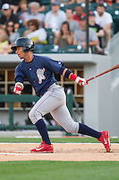 Ronny Cedeno (5) of the Lehigh Valley IronPigs follows through on his swing against the Charlotte Knights at BB&T Ballpark on May 8, 2014 in Charlotte, North Carolina.  The IronPigs defeated the Knights 8-6.  (Brian Westerholt/Four Seam Images)