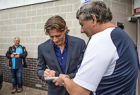 Gareth Ainsworth Manager of Wycombe Wanderers arrives and signs an autograph for a fan prior to the Sky Bet League 2 match between Crawley Town and Wycombe Wanderers at Checkatrade.com Stadium, Crawley, England on 29 August 2015. Photo by Liam McAvoy.