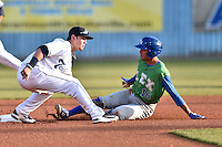 Asheville Tourists shortstop Brendan Rodgers (1) attempts to put a tag on a hard sliding Marten Gasparini (16) during a game against the Lexington Legends at McCormick Field on April 18, 2016 in Asheville, North Carolina. The Legends defeated the Tourists 7-5. (Tony Farlow/Four Seam Images)