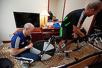 08 SEP 2011 - BEIJING, CHN - Iain Dawson (left) prepares his tandem with guide Liam Gentry at their hotel before the ITU World Paratriathlon Championships (PHOTO (C) NIGEL FARROW)