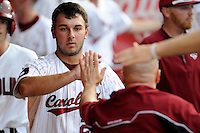 Designated hitter Max Schrock (22) of the South Carolina Gamecocks is congratulated after scoring a run in an NCAA Division I Baseball Regional Tournament game against the Campbell Camels on Friday, May 30, 2014, at Carolina Stadium in Columbia, South Carolina. South Carolina won, 5-2. (Tom Priddy/Four Seam Images)