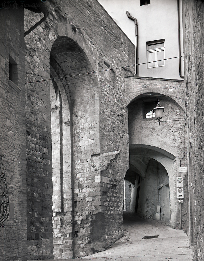 """""""Gate and Arches""""<br /> Montepulciano, Italy<br /> <br /> Travels must pass through the main narrow portals to enter the Tuscan town of Montepulciano.  Several archways are visible before reaching the piazza.<br /> <br /> 4 x 5 Large Format Film"""