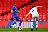 25th March 2021; Wembley Stadium, London, England;  Jesse Lingard England takes on Brolli Cristian of San Marino during the World Cup 2022 Qualification match between England and San Marino at Wembley Stadium in London, England.