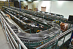 Interior large warehouse. Motion effect of freight moving on conveyor belts.