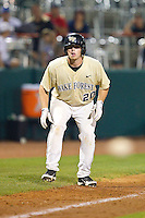 Jack Carey #20 of the Wake Forest Demon Deacons takes his lead off of third base against the Miami Hurricanes at NewBridge Bank Park on May 25, 2012 in Winston-Salem, North Carolina.  The Hurricanes defeated the Demon Deacons 6-3.  (Brian Westerholt/Four Seam Images)