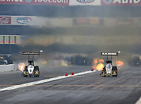 Feb 9, 2014; Pomona, CA, USA; NHRA top fuel dragster driver Khalid Albalooshi (left) races alongside Tony Schumacher during the Winternationals at Auto Club Raceway at Pomona. Mandatory Credit: Mark J. Rebilas-