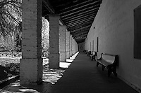 """Interior arcade surrounds the patio at Mission San Antonio de Padua. Mission San Antonio de Padua sits within the """"Valley of the Oaks"""" in Monterey County near the town of Jolon. The mission was founded on July 14, 1771 by Father Junipero Serra and was the third mission in Alta California. Mission San Antonio de Padua is located on eighty pristine acres on what was once the Milpitas Unit of the Hearst Ranch and is today surrounded by the Army's Fort Hunter Ligget Military Reservation."""