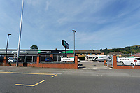 Pictured: The Enterprise car rental with the car wash and the house owned by Anne Parker seen in the far distance in Pontypridd, Wales, UK. Monday 02 July 2018<br /> Re: Pensioner Anne Parker says the peace and quiet of her garden has been shattered after a car wash was installed by rental firm Enterprise on the other side of her back fence in Pontypridd, Wales, UK.