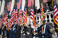 Representatives from the Veterans Service Organization hold flags along the lower wall of the Memorial Amphitheater on Veterans Day at Arlington National Cemetery, Arlington, Virginia, Nov. 11, 2017.  (U.S. Army photo by Elizabeth Fraser / Arlington National Cemetery / released)
