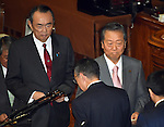 December 24, 2014, Tokyo, Japan - Veteran lawmakers Ichiro Ozawa, foreground, and Takeo Hiranuma cast their ballots in a parliamentary process to elect Japan's new leader during a special Diet session convened in Tokyo on Wednesday, December 24, 2014. Shinzo Abe was re-elected as prime minister following a landsilide victory by the Liberal Democratic Party in the December 14 general election.  (Photo by Natsuki Sakai/AFLO)