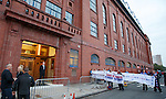 Sons of Struth demonstrate outside the front door of Ibrox before the match