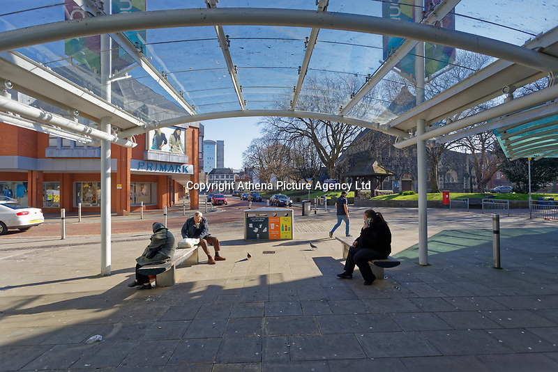 Pictured: People rest on benches in the city centre of Swansea, Wales, UK. Wednesday 25 March 2020 <br /> Re: Covid-19 Coronavirus pandemic, UK.
