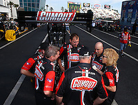 Mar 16, 2014; Gainesville, FL, USA; Crew membersfor NHRA top fuel driver Leah Pritchett huddle in the staging lanes during the Gatornationals at Gainesville Raceway Mandatory Credit: Mark J. Rebilas-USA TODAY Sports