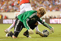 Philadelphia Union goalkeeper Brian Perk (24) makes a save on Danny Welbeck (19) of Manchester United after fumbling a ball. Manchester United (EPL) defeated the Philadelphia Union (MLS) 1-0 during an international friendly at Lincoln Financial Field in Philadelphia, PA, on July 21, 2010.