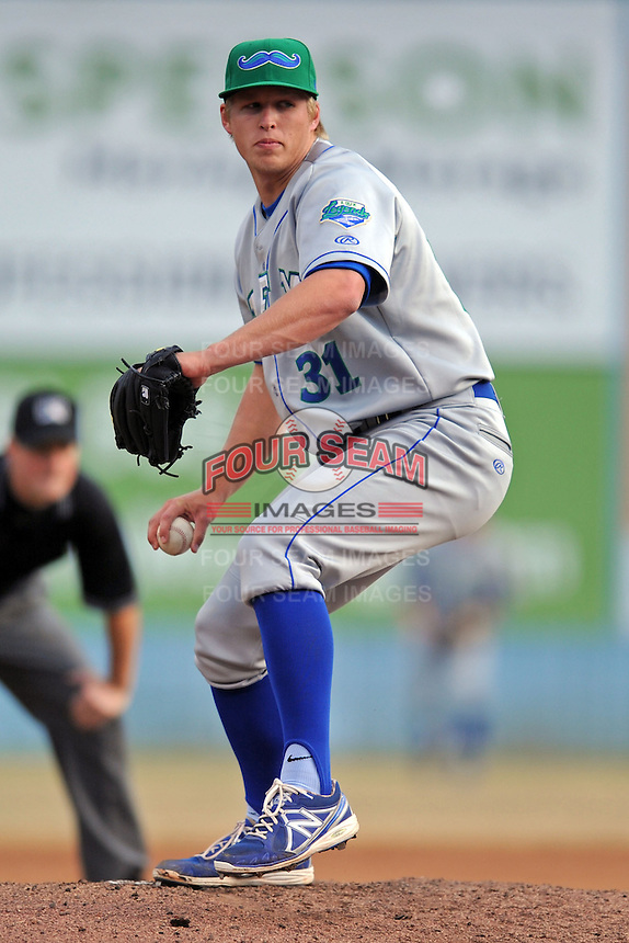 Lexington Legends starting pitcher Bryan Brickhouse #31 delivers a pitch during a game against the  Asheville Tourists at McCormick Field on April 23, 2013 in Asheville, North Carolina. The Tourists won the game 4-3. (Tony Farlow/Four Seam Images).