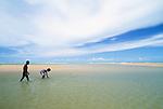 Youths exploring tidepools, Tiwi people, Bathurst Island, Australia
