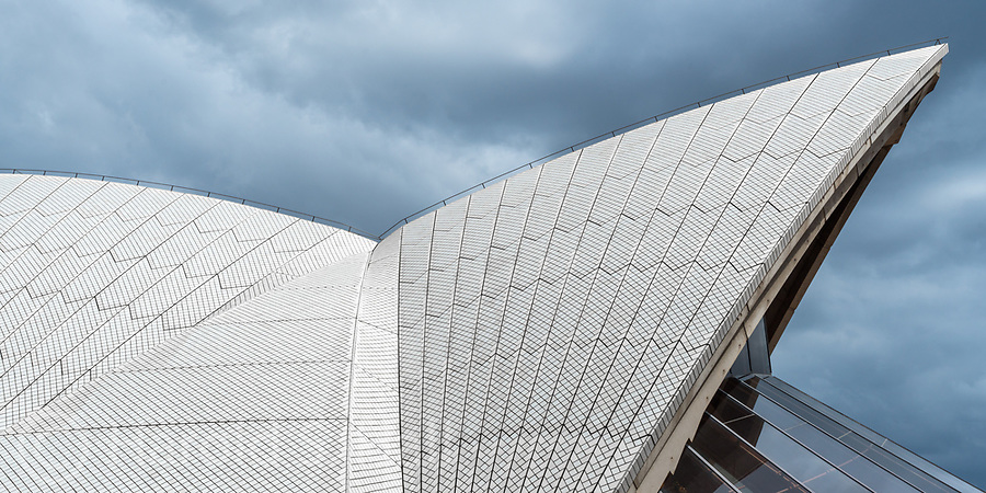 The Sydney Opera House is one of the world's most identifiable images.  Hers is a view of the roof line with an approaching storm.