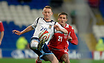 International Friendly match between Wales and Scotland at the new Cardiff City Stadium : Scotlands' Derek Riordan beats Wales' Andy King to the ball.