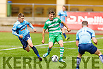Killarneys Athletics Lee Dowling on a forward run as Sean O'Shea of Rathkeale keeps a close eye on him, in the Munster Junior Cup Final on Sunday.