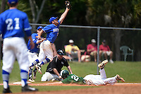U-Mass Boston Beacons Daniel Mantoni (7) jumps for a throw as Tom Rydzewski (24) slides into third during a game against the Farmingdale State Rams at North Charlotte Regional Park on March 19, 2015 in Port Charlotte, Florida.  U-Mass Boston defeated Farmingdale 9-5.  (Mike Janes/Four Seam Images)