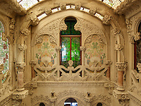 Vivid, green glass panes in one of the doors brings a spark of luminous colour to the main staircase, and highlights the green of the mosaic tiles on the walls
