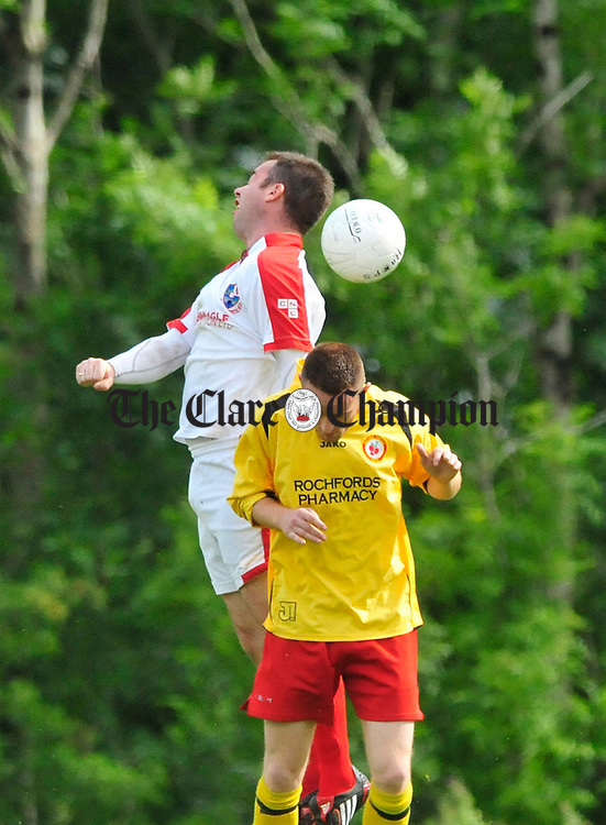 David O' Brien of Corofin clashes with Anthony White of Avenue Utd. Photograph by Declan Monaghan