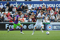 Matty Taylor of Bristol City battles with Joe Rodon of Swansea City during the Sky Bet Championship match between Swansea City and Bristol City at the Liberty Stadium, Swansea, Wales, UK. Saturday 25 August 2018
